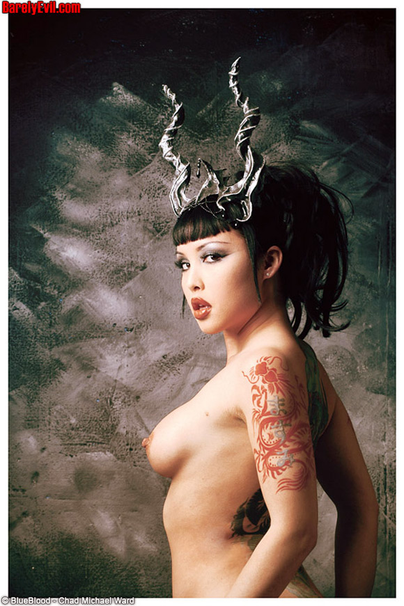 Busty Tattooed Naked Eurasian Girl Wearing Horns Stripping Pletely