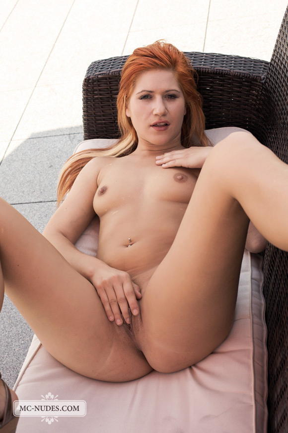 horny-redhead-babe-getting-completely-naked-on-balcony