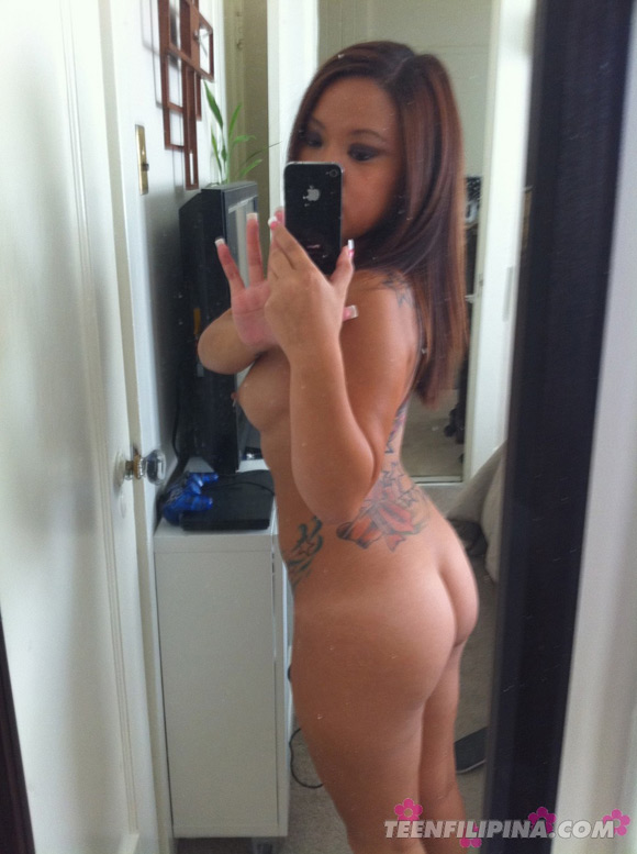 filipina-american-girl-friend-shows-off-her-tats-and-piercings